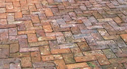 Showing the coloration with an interesting pattern of brick pavers.