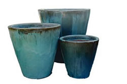 A few tall blue-green cone shaped pots