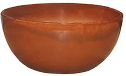 A large reddish brown low bowl