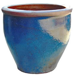 A large blue pot with a rustic rim