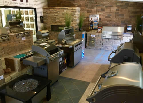 Showroom of several types of outdoor grills and fireplaces.