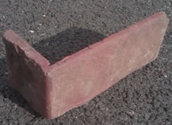 A single thin brick paver L shaped
